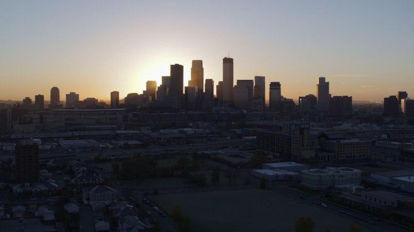 5.7K aerial video flyby the city's skyline as the sun rises in Downtown Minneapolis, Minnesota Aerial Stock Footage | DX0001_002069