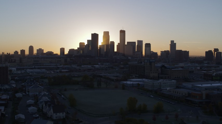 5.7K stock footage aerial video a view of the city's skyline with the sunrise, seen during descent in Downtown Minneapolis, Minnesota Aerial Stock Footage | DX0001_002070