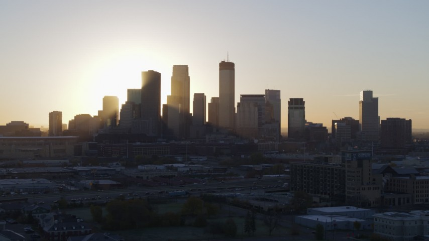 5.7K stock footage aerial video a slow ascent while focusing on the city skyline at sunrise in Downtown Minneapolis, Minnesota Aerial Stock Footage | DX0001_002071