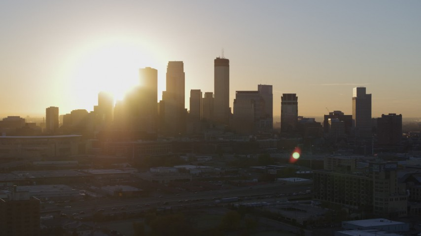 5.7K stock footage aerial video a slow flyby while focusing on the city skyline at sunrise in Downtown Minneapolis, Minnesota Aerial Stock Footage | DX0001_002072