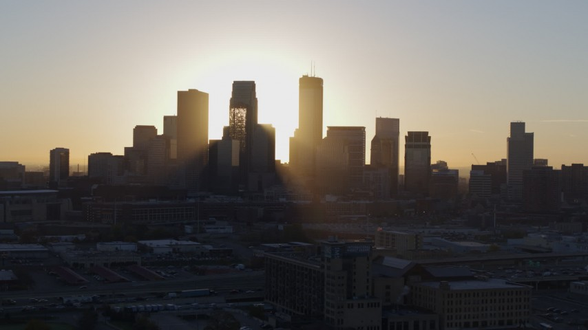 5.7K stock footage aerial video of focusing on the city skyline at sunrise during slow flyby in Downtown Minneapolis, Minnesota Aerial Stock Footage | DX0001_002073
