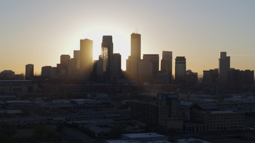 5.7K stock footage aerial video focus on city skyline at sunrise during slow flyby and descent in Downtown Minneapolis, Minnesota Aerial Stock Footage | DX0001_002074