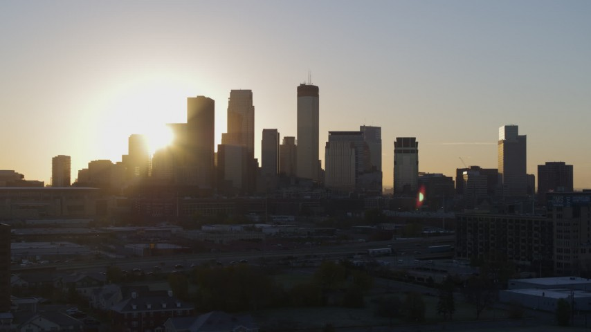 5.7K stock footage aerial video focus on city skyline at sunrise during slow flyby and ascent in Downtown Minneapolis, Minnesota Aerial Stock Footage | DX0001_002075