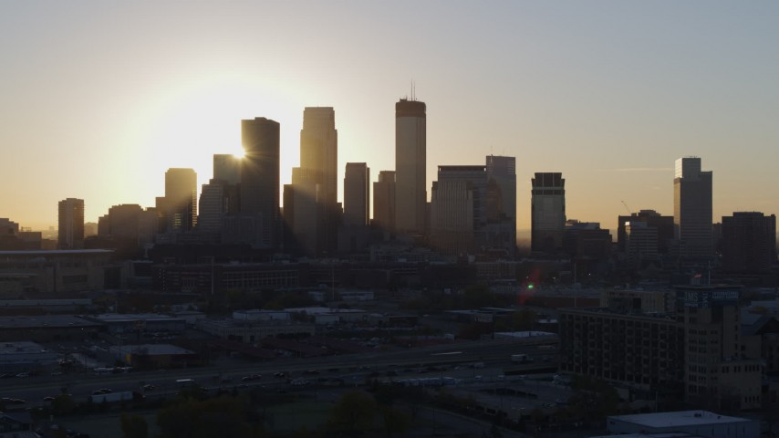 5.7K stock footage aerial video focus on city skyline at sunrise during slow pass in Downtown Minneapolis, Minnesota Aerial Stock Footage | DX0001_002076