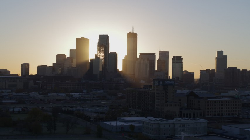 5.7K stock footage aerial video focus on city skyline at sunrise in Downtown Minneapolis, Minnesota Aerial Stock Footage | DX0001_002077