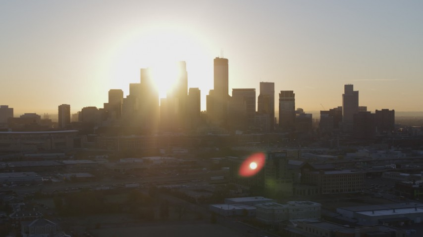5.7K stock footage aerial video of the rising sun behind the city skyline in Downtown Minneapolis, Minnesota Aerial Stock Footage | DX0001_002079