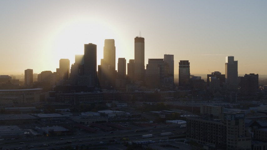 5.7K stock footage aerial video ascend near the city's skyline at sunrise in Downtown Minneapolis, Minnesota Aerial Stock Footage | DX0001_002082