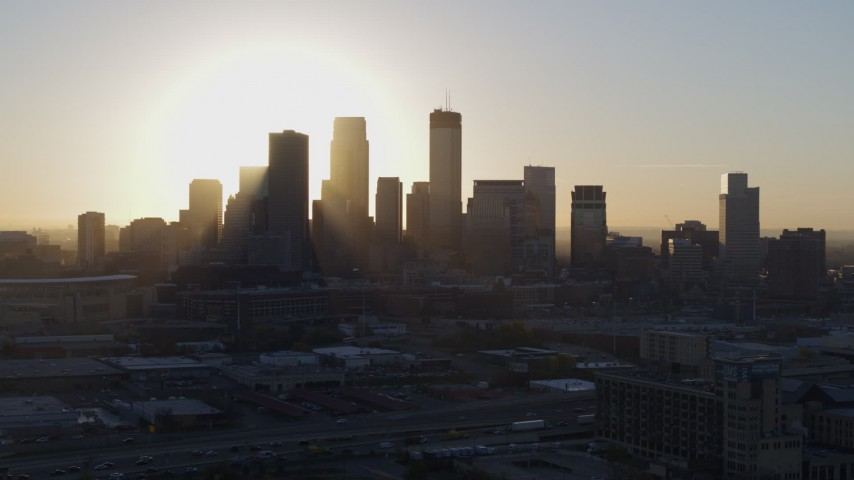 5.7K stock footage aerial video descend near the city's skyline at sunrise in Downtown Minneapolis, Minnesota Aerial Stock Footage | DX0001_002083