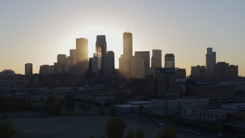 5.7K stock footage aerial video descend and flyby the city's skyline at sunrise in Downtown Minneapolis, Minnesota Aerial Stock Footage | DX0001_002084