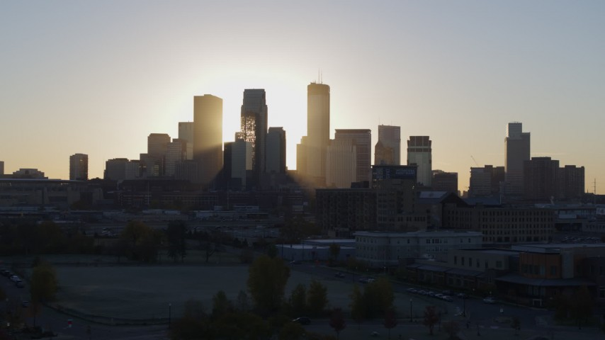 5.7K stock footage aerial video flyby the city's skyline at sunrise in Downtown Minneapolis, Minnesota Aerial Stock Footage | DX0001_002085