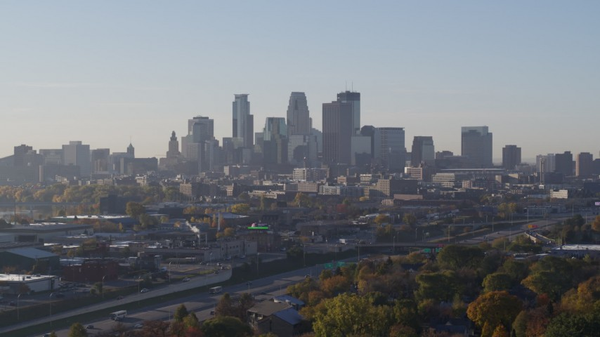 5.7K stock footage aerial video slowly flying by the city's downtown skyline during descent at sunrise in Downtown Minneapolis, Minnesota Aerial Stock Footage | DX0001_002092