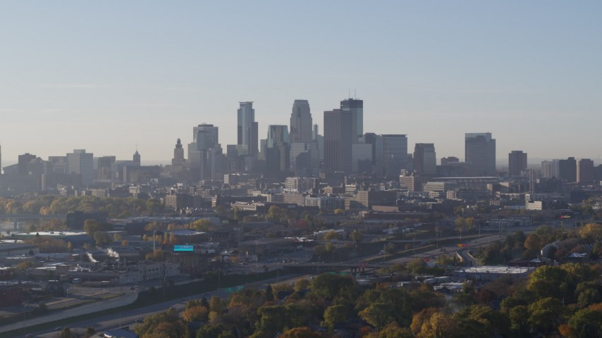 5.7K stock footage aerial video slowly flyby the city's downtown skyline at sunrise during ascent in Downtown Minneapolis, Minnesota Aerial Stock Footage | DX0001_002095