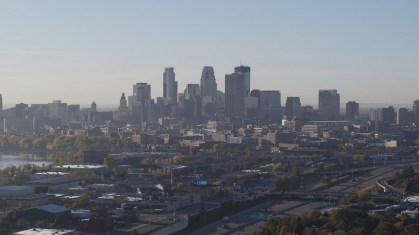 5.7K stock footage aerial video slowly pass the city's downtown skyline at sunrise in Downtown Minneapolis, Minnesota Aerial Stock Footage DX0001_002096 | Axiom Images