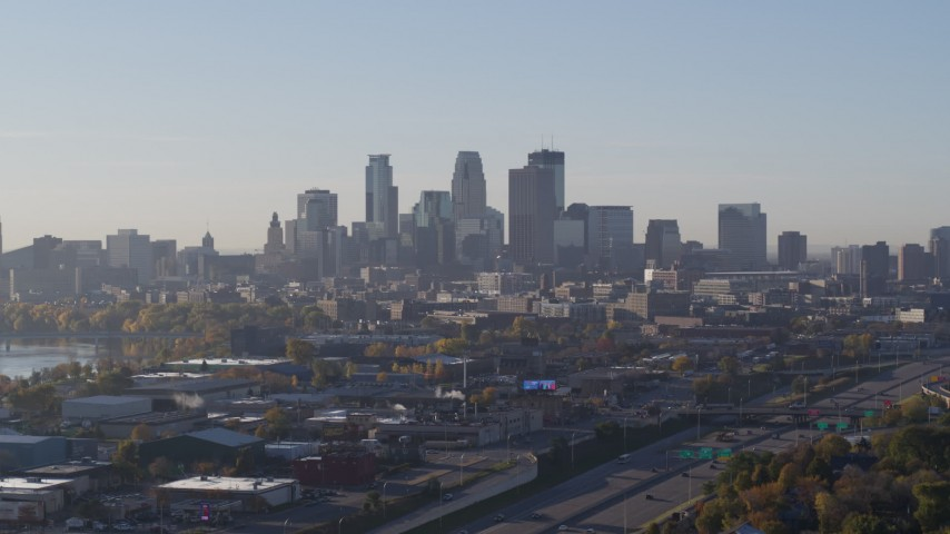 5.7K stock footage aerial video descending with view of the city's downtown skyline at sunrise in Downtown Minneapolis, Minnesota Aerial Stock Footage | DX0001_002097