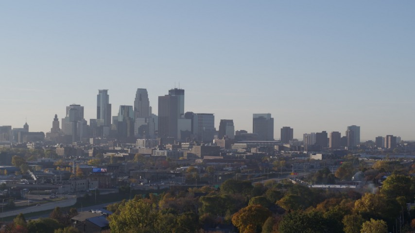 5.7K stock footage aerial video ascend to reveal the city's downtown skyline at sunrise in Downtown Minneapolis, Minnesota Aerial Stock Footage | DX0001_002099