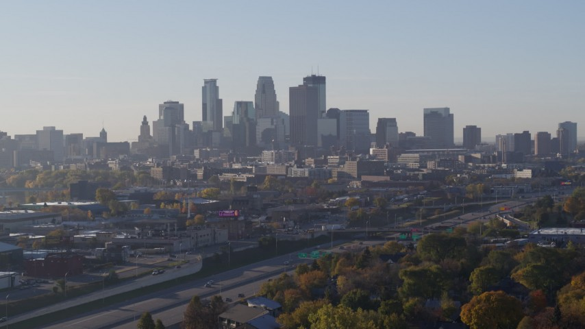 5.7K stock footage aerial video ascend from park to reveal the city's downtown skyline at sunrise in Downtown Minneapolis, Minnesota Aerial Stock Footage | DX0001_002100