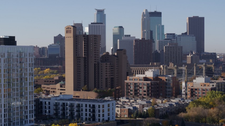 5.7K stock footage aerial video descend near condo complex with view of city's skyline at sunrise in Downtown Minneapolis, Minnesota Aerial Stock Footage | DX0001_002111