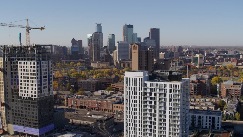 5.7K stock footage aerial video of a view of the city's skyline seen from apartment building at sunrise in Downtown Minneapolis, Minnesota Aerial Stock Footage | DX0001_002114