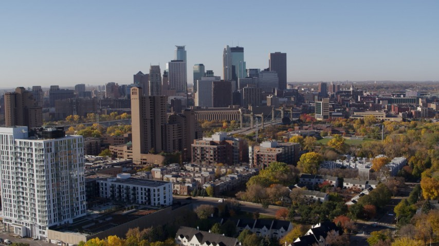 5.7K stock footage aerial video of the city's skyline seen from apartment building at sunrise in Downtown Minneapolis, Minnesota Aerial Stock Footage | DX0001_002115