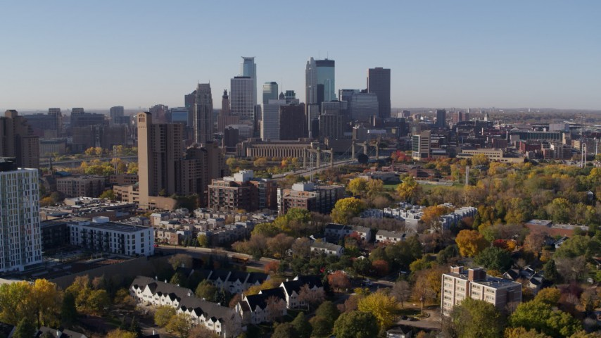 5.7K stock footage aerial video of city's skyline seen from an apartment building at sunrise in Downtown Minneapolis, Minnesota Aerial Stock Footage | DX0001_002116