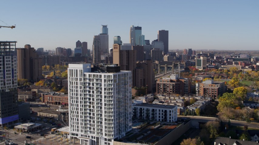 5.7K stock footage aerial video of city's skyline and an apartment building at sunrise in Downtown Minneapolis, Minnesota Aerial Stock Footage | DX0001_002117