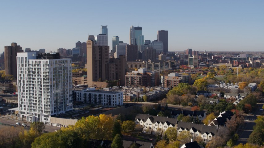 5.7K stock footage aerial video of flyby apartment building at sunrise, condo complex and skyline in background in Downtown Minneapolis, Minnesota Aerial Stock Footage | DX0001_002119