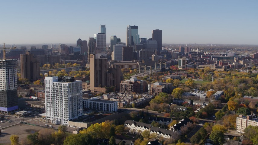 5.7K stock footage aerial video apartment complex in foreground and skyline in background in Downtown Minneapolis, Minnesota Aerial Stock Footage | DX0001_002120