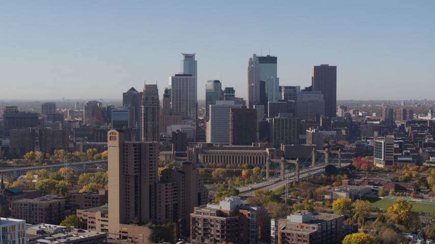 5.7K stock footage aerial video ascend and flyby a view of skyline seen from residential area in Downtown Minneapolis, Minnesota Aerial Stock Footage | DX0001_002125