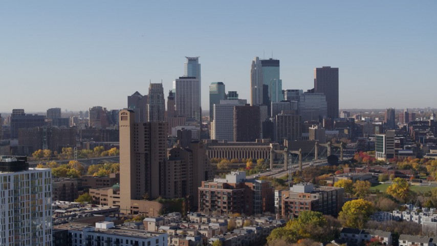 5.7K stock footage aerial video ascend by residential building with view of skyline at sunrise in Downtown Minneapolis, Minnesota Aerial Stock Footage | DX0001_002127
