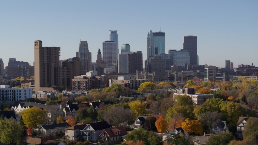 5.7K stock footage aerial video the downtown skyline seen from residential neighborhood at sunrise in Downtown Minneapolis, Minnesota Aerial Stock Footage | DX0001_002130