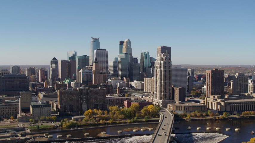5.7K stock footage aerial video a view of the skyline while ascending by the river in Downtown Minneapolis, Minnesota Aerial Stock Footage | DX0001_002134