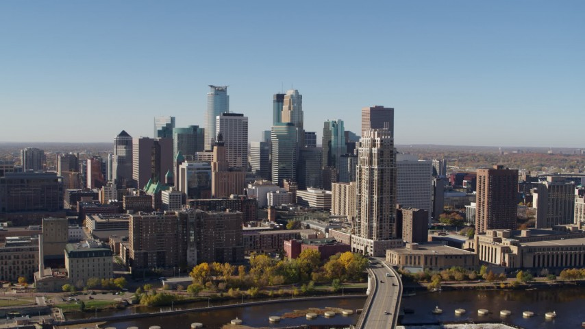 5.7K stock footage aerial video slowly flying by the skyline, seen from the river in Downtown Minneapolis, Minnesota Aerial Stock Footage | DX0001_002135