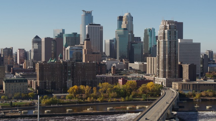 5.7K stock footage aerial video flying by the skyline on the other side of the Mississippi River, Downtown Minneapolis, Minnesota Aerial Stock Footage | DX0001_002149