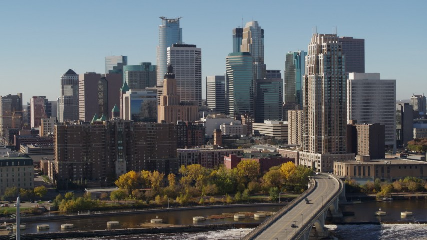 5.7K stock footage aerial video passing by the skyline on the other side of the Mississippi River, Downtown Minneapolis, Minnesota Aerial Stock Footage | DX0001_002150