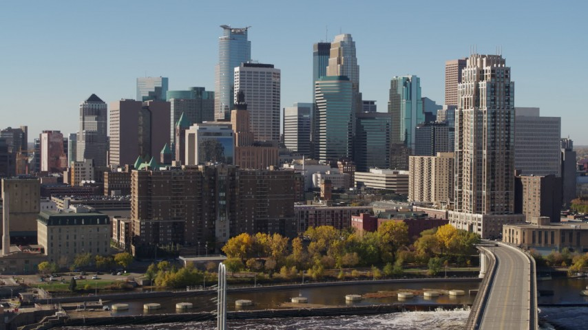 5.7K stock footage aerial video pass by the skyline on the other side of the Mississippi River, Downtown Minneapolis, Minnesota Aerial Stock Footage | DX0001_002151