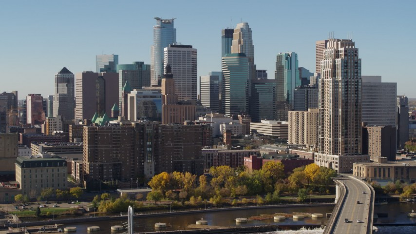 5.7K stock footage aerial video flyby the skyline on the other side of the Mississippi River during ascent, Downtown Minneapolis, Minnesota Aerial Stock Footage | DX0001_002152