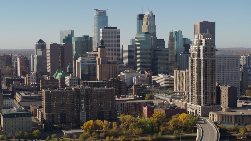 5.7K stock footage aerial video flying by the city's skyline, seen from opposite side of the river, Downtown Minneapolis, Minnesota Aerial Stock Footage | DX0001_002153