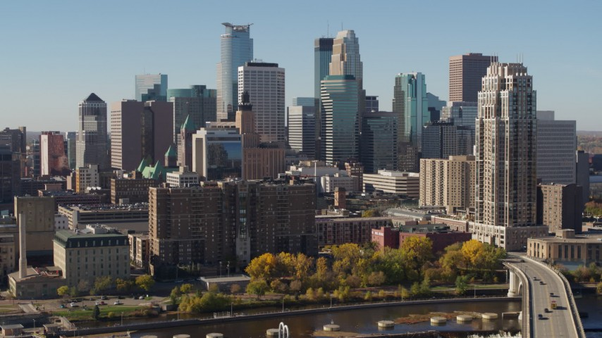 5.7K stock footage aerial video passing by the city's skyline, seen from opposite side of the river, Downtown Minneapolis, Minnesota Aerial Stock Footage | DX0001_002154