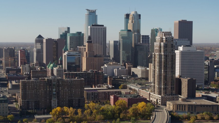 5.7K stock footage aerial video ascend by the city's skyline, seen from opposite side of the river, Downtown Minneapolis, Minnesota Aerial Stock Footage | DX0001_002155