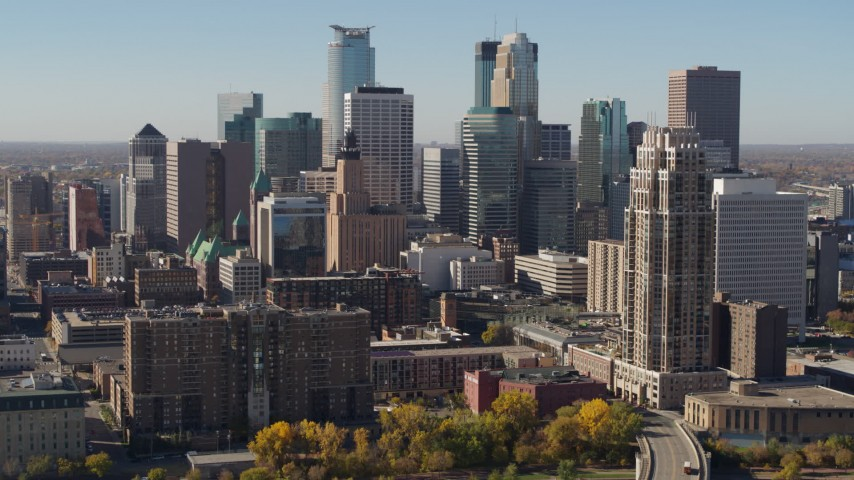 5.7K stock footage aerial video pass by the city's skyline during descent, seen from the river, Downtown Minneapolis, Minnesota Aerial Stock Footage | DX0001_002156
