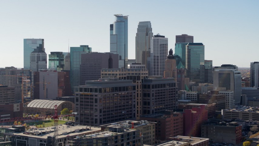 5.7K stock footage aerial video reverse view of office building and city's skyline, Downtown Minneapolis, Minnesota Aerial Stock Footage | DX0001_002158