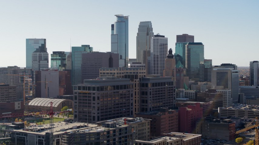 5.7K stock footage aerial video passing by office building and city's skyline, Downtown Minneapolis, Minnesota Aerial Stock Footage | DX0001_002159