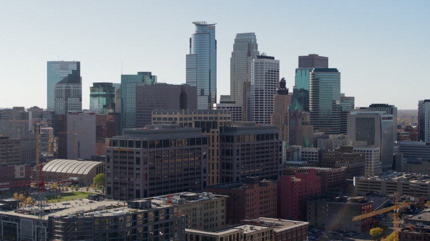5.7K stock footage aerial video flyby office building and city's skyline, Downtown Minneapolis, Minnesota Aerial Stock Footage | DX0001_002160