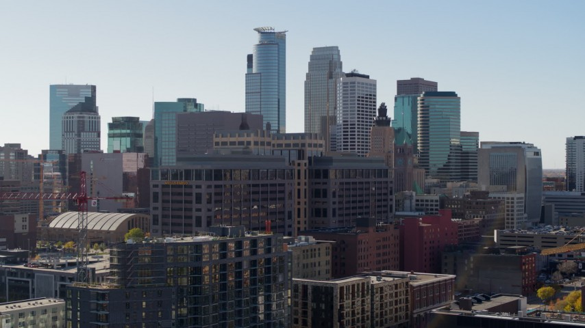 5.7K stock footage aerial video descend near office building and city's skyline, Downtown Minneapolis, Minnesota Aerial Stock Footage | DX0001_002161