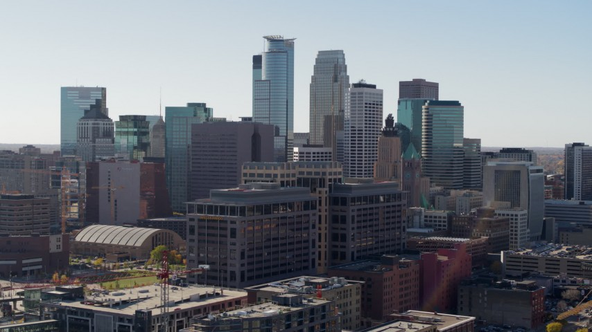 5.7K stock footage aerial video fly near office building and city's skyline and ascend, Downtown Minneapolis, Minnesota Aerial Stock Footage | DX0001_002162