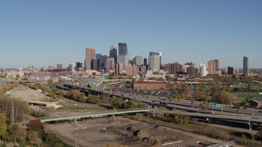 5.7K stock footage aerial video flying away from the skyline of Downtown Minneapolis, Minnesota, seen from freeway Aerial Stock Footage | DX0001_002168