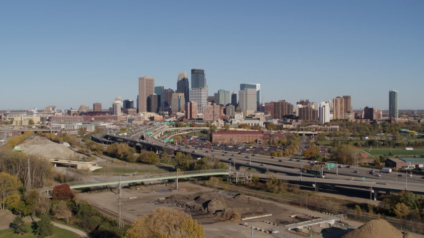 5.7K stock footage aerial video reverse view of I-394 freeway and the skyline of Downtown Minneapolis, Minnesota Aerial Stock Footage | DX0001_002168