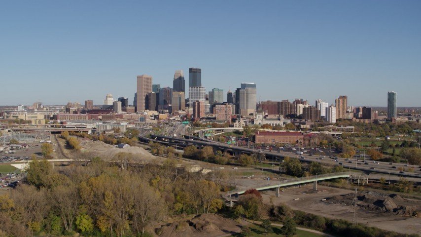 5.7K stock footage aerial video flying by I-394 freeway and the skyline of Downtown Minneapolis, Minnesota Aerial Stock Footage | DX0001_002169