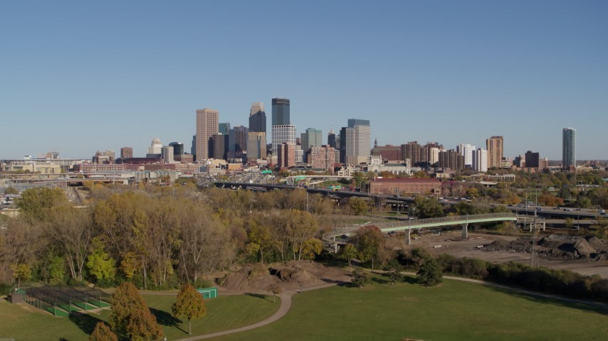 5.7K stock footage aerial video a wide view of the city skyline while flying over a park, Downtown Minneapolis, Minnesota Aerial Stock Footage | DX0001_002172