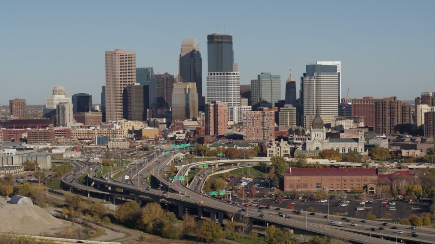 5.7K stock footage aerial video flyby the freeway and then approach the city skyline, Downtown Minneapolis, Minnesota Aerial Stock Footage | DX0001_002181
